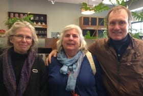 Writer and Manager of the General Books Division at the Coop, Suzy Staubach, with friends Nan Sorensen and George Gibson.