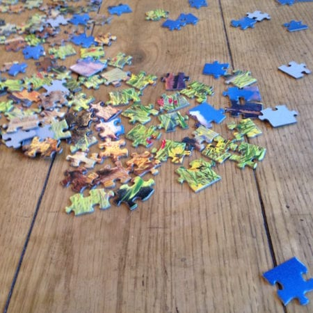 jigsaw pieces on a table