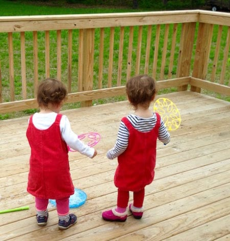 Two toddlers with bubble wands